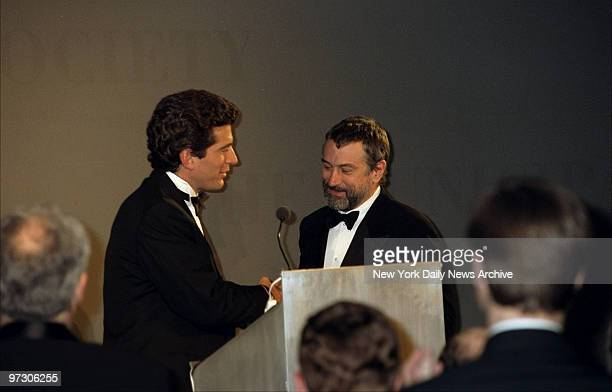 John F Kennedy Jr presents Robert De Niro with the Jacqueline Kennedy Onassis Medal during the Municipal Art Society Gala at 440 Lafayette St
