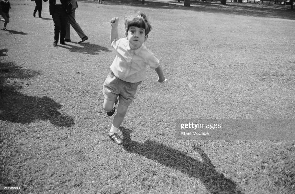 John F Kennedy Jr (1960 - 1999) takes a dislike to photographer Albert McCabe in Green Park. London, 13th May 1965.