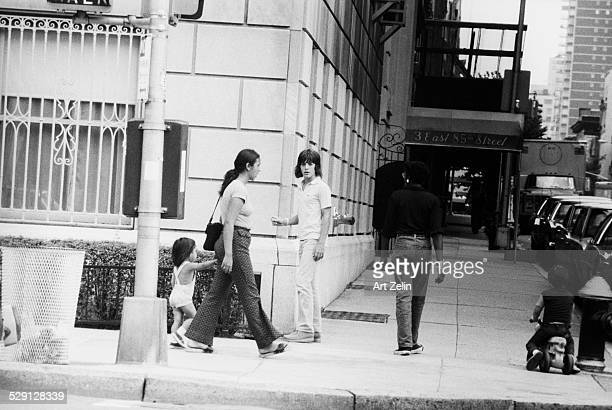 John F Kennedy Jr walking near 3 E 85th St circa 1970 New York