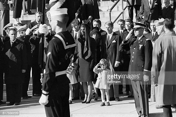 John F Kennedy Jr who turns three today salutes as the casket of his father the late President John F Kennedy is carried from St Matthew's Cathedral...