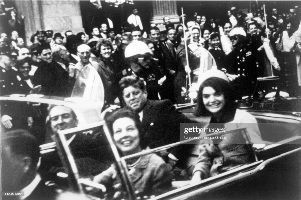 John F Kennedy motorcade Dallas Texas USA 22 November 1963 Closeup view of President and Mrs Kennedy and Texas Governor John Connally and his wife...