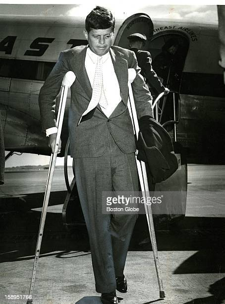 John F Kennedy on crutches with back pain He suffered a ruptured disk during the war