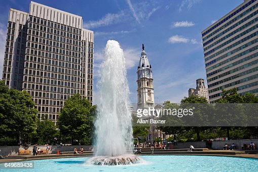 John F Kennedy plaza against blue skies with fountain : Stock Photo