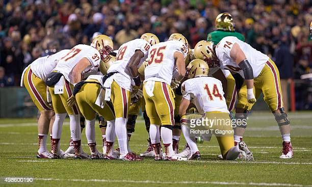John Fadule of the Boston College Eagles huddles with teammates Dave Bowen Tyler Rouse Thad Smith and Michael Walker during a game against the Notre...