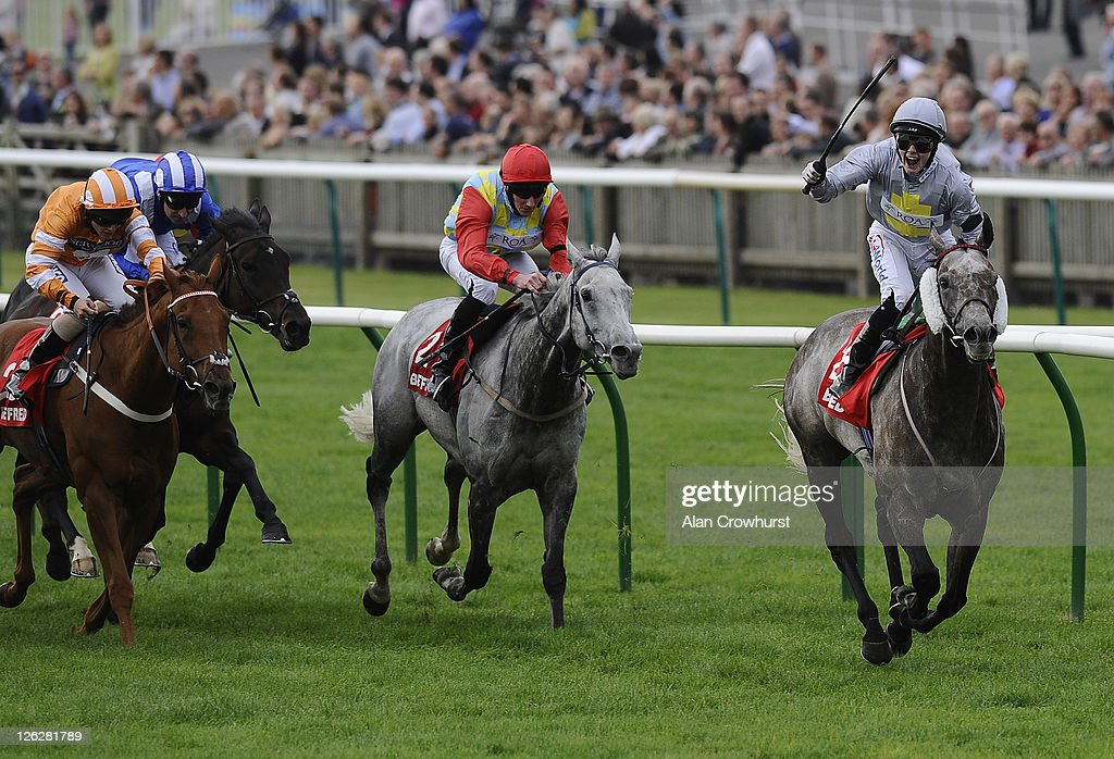 John Fahy riding Prince of Johanne (R) win The Betfred Cambridgeshire at Newmarket racecourse on September 24, 2011 in Newmarket, England.