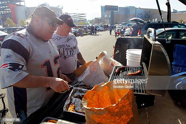 John Fallon of Bourne front and friend Mike Flashner of Randolph grill sausages before the game The two friends originally from Dorchester have been...