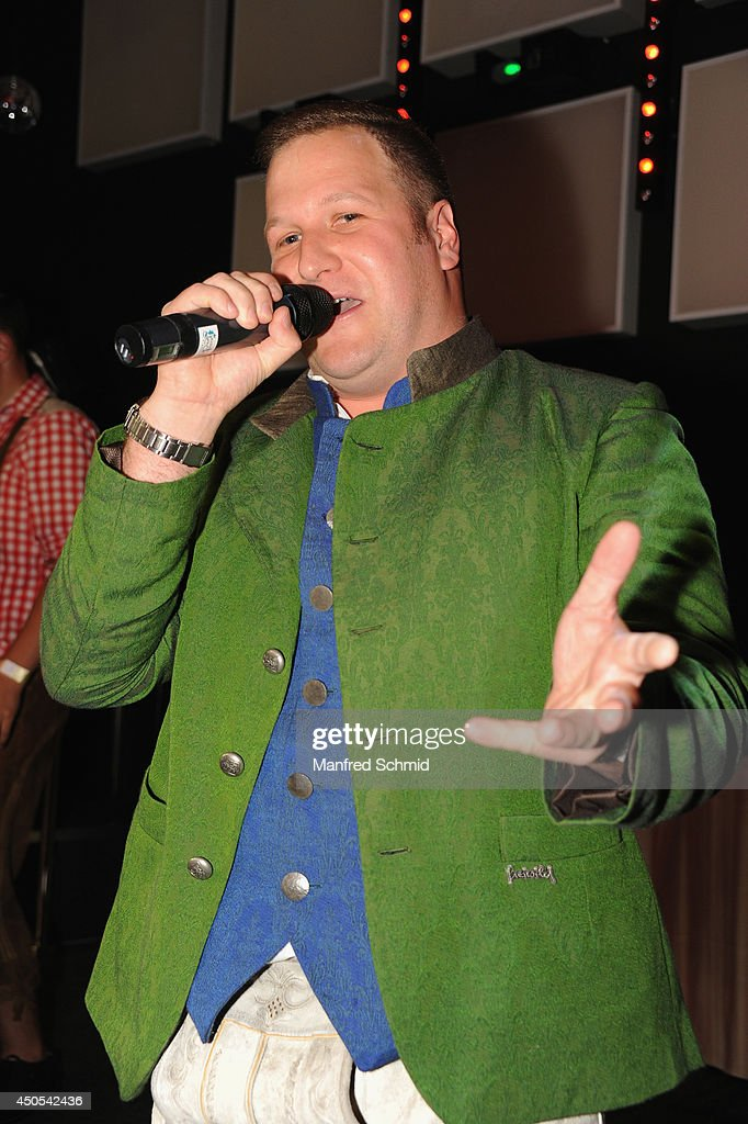 John Farma performs on stage during the beauty competition 'Miss Wiener Wiesn-Fest 2014' at Platzhirsch on on June 12, 2014 in Vienna, Austria.