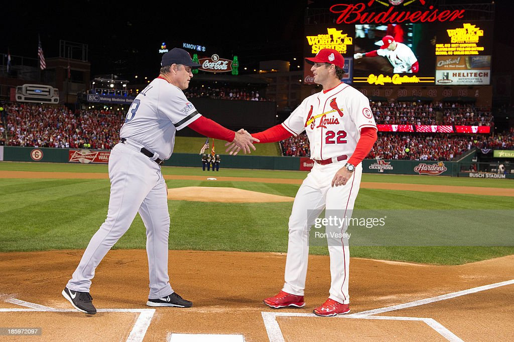 John Farrell #53 manager of the Boston Red Sox and Mike Matheny #22 manager of the St. Louis Cardinals shake hands at home plate during the pre-game ceremonies before Game 3 of the 2013 World Series between the St. Louis Cardinals and the Boston Red Sox at Busch Stadium on Saturday, October 26, 2013 in St. Louis, Missouri.