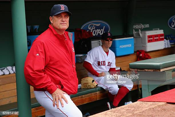 BOSTON MASSACHUSETTS John Farrell Manager of the Boston Red Sox looks on from the dugout before the Red Sox home opener against the Baltimore Orioles...