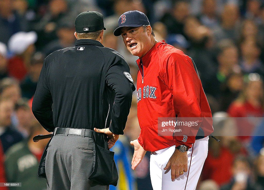 John Farrell #53 of the Boston Red Sox argues with home plate umpire Cory Blaser over a play at the plate that went in favor of Minnesota Twins in the 5th inning at Fenway Park on May 6, 2013 in Boston, Massachusetts.