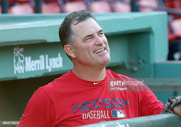 John Farrell of the Boston Red Sox makes a visit to the dugout before a game against the Cleveland Indians at Fenway Park on August 19 2015 in Boston...