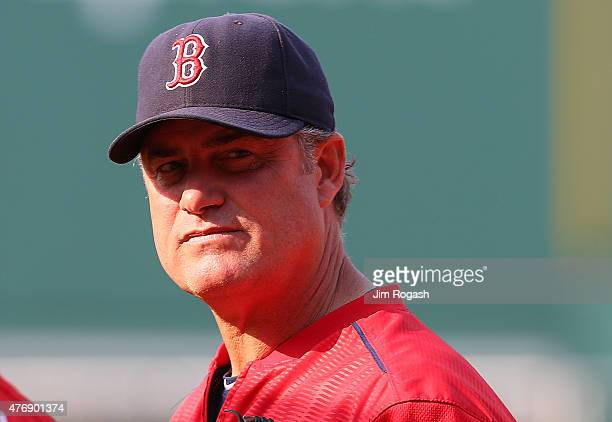 John Farrell of the Boston Red Sox manager of the Boston Red Sox watches batting practice before a game with the Toronto Blue Jays at Fenway Park on...