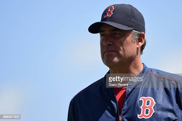 John Farrell of the Boston Red Sox walks to the dugout during a spring training game against the New York Mets at JetBlue Park at Fenway South on...