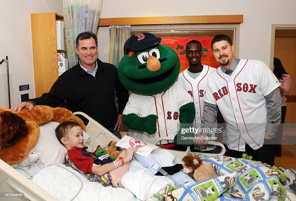 John Farrell, Wally The Green Monster, <a gi-track='captionPersonalityLinkClicked' href=/galleries/search?phrase=Pedro+Ciriaco&family=editorial&specificpeople=5718591 ng-click='$event.stopPropagation()'>Pedro Ciriaco</a> and Ryan Lavarnway of the Boston Red Sox visit Ian for the Holiday at Boston Children's Hospital on November 30, 2012 in Boston, Massachusetts.