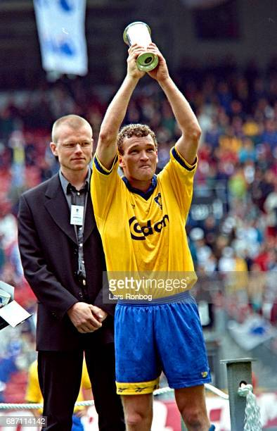 John Faxe Jensen of Brondby IF with the trophy as Man of the Match after the Danish Cup Final Compaq Cup match between FC Copenhagen and Brondby IF...