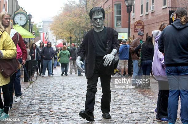 John Febonio of Lynn Mass strolls as Frankenstein down the Essex Street pedestrian mall during the October long preHalloween Haunted Happenings...