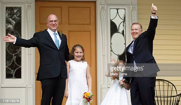 John Feinblatt and Jonathan Mintz celebrate after marrying with their daughters Maeve and Georgia at Gracie Mansion on July 24 2011 in New York City...
