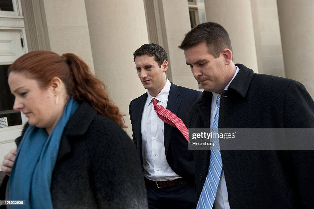 John Femenia, a former Wells Fargo & Co. investment banker, center, and his attorneys Ellen Murphy, left, and Mark Jones exit the Charles R. Jonas Federal Building U.S. Courthouse in Charlotte, North Carolina, U.S., on Friday, Dec. 21, 2012. Femenia was charged last week with leading an $11 million insider trading ring that paid kickbacks in cash and gold for tips on corporate mergers. Photographer: Davis Turner/Bloomberg via Getty Images