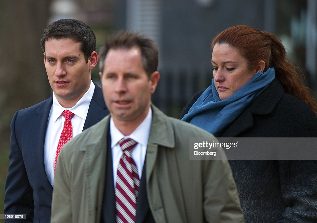 John Femenia, a former Wells Fargo & Co. investment banker, left, arrives with his attorney Scott Morvillo, center, at the Charles R. Jonas Federal Building U.S. Courthouse in Charlotte, North Carolina, U.S., on Friday, Dec. 21, 2012. Femenia was charged last week with leading an $11 million insider trading ring that paid kickbacks in cash and gold for tips on corporate mergers. Photographer: Davis Turner/Bloomberg via Getty Images