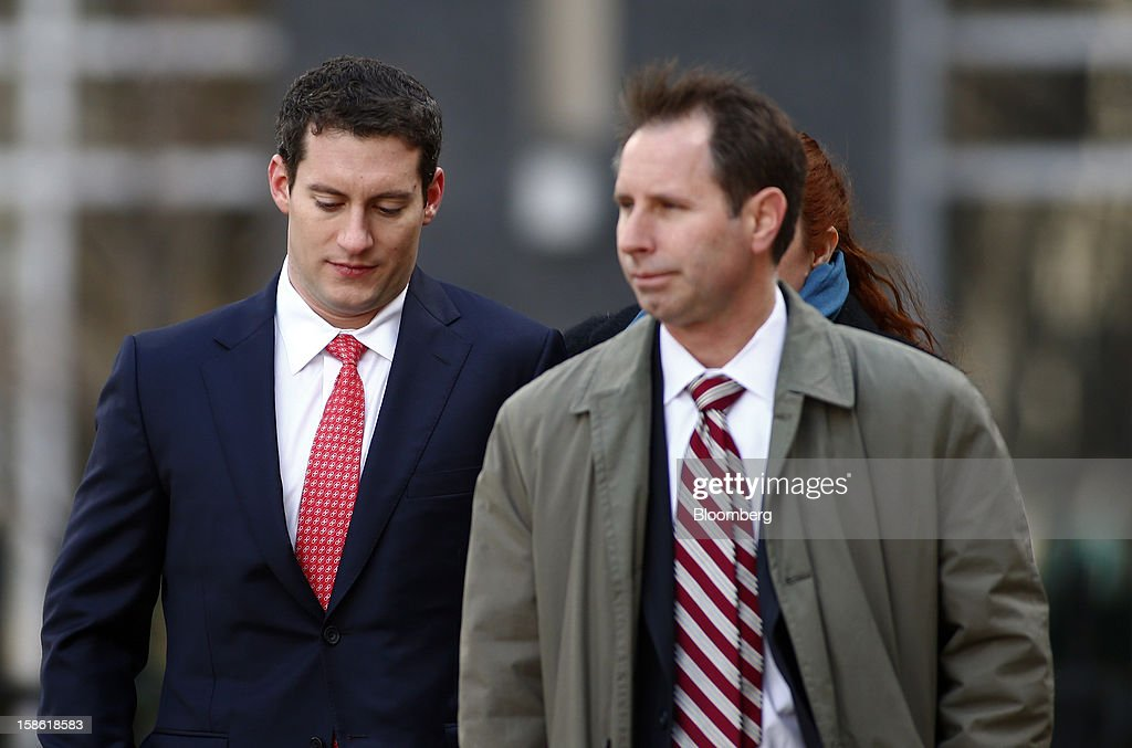 John Femenia, a former Wells Fargo & Co. investment banker, left, arrives with his attorney Scott Morvillo at the Charles R. Jonas Federal Building U.S. Courthouse in Charlotte, North Carolina, U.S., on Friday, Dec. 21, 2012. Femenia was charged last week with leading an $11 million insider trading ring that paid kickbacks in cash and gold for tips on corporate mergers. Photographer: Chris Keane/Bloomberg via Getty Images