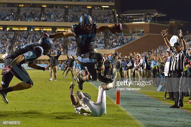 John Ferranto of the North Carolina Tar Heels hurdles DJ White of the Georgia Tech Yellow Jackets on a twopoint conversion with 11 seconds to play...