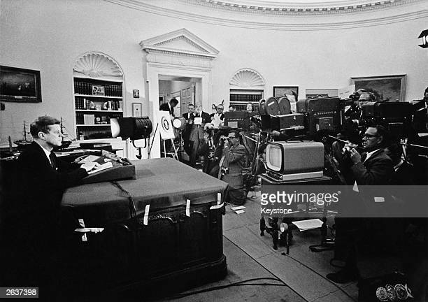 John Fitzgerald Kennedy American president announcing on television the strategic blockade of Cuba and his warning to the Soviet Union about missile...