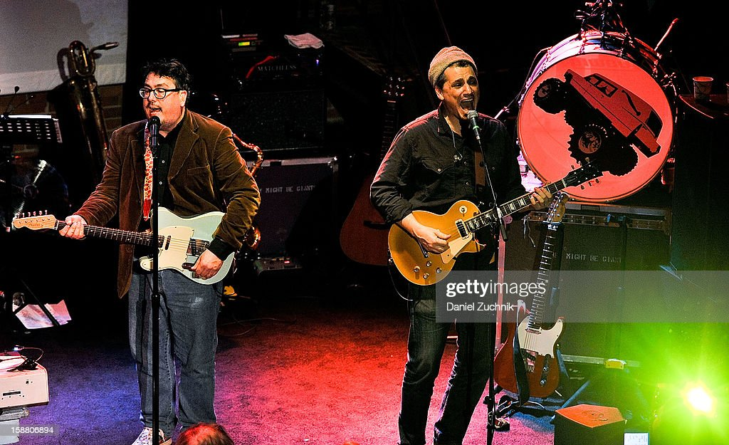 <a gi-track='captionPersonalityLinkClicked' href=/galleries/search?phrase=John+Flansburgh&family=editorial&specificpeople=3117860 ng-click='$event.stopPropagation()'>John Flansburgh</a> and <a gi-track='captionPersonalityLinkClicked' href=/galleries/search?phrase=Dan+Miller+-+Gitarrist&family=editorial&specificpeople=15028071 ng-click='$event.stopPropagation()'>Dan Miller</a> of They Might Be Giants perform at Music Hall of Williamsburg on December 29, 2012 in the Brooklyn borough of New York City.