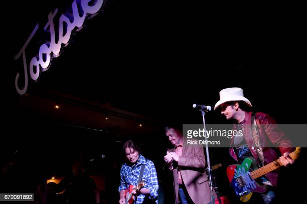 John Fogerty Bill Anderson and Brad Paisley perform onstage at Tootsie's Orchid Lounge after the Brad Paisley LOVE AND WAR Album Launch Event on...