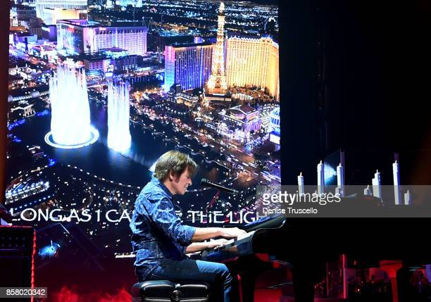 John Fogerty performs 'As Long As I Can See The Light' for the victims and families of the Las Vegas tragedy during his show at Wynn Las Vegas on...