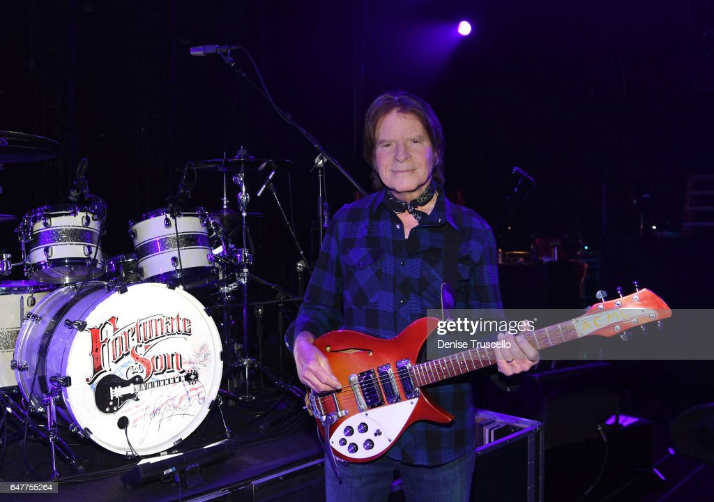 John Fogerty poses for a photo with his 1969 Rickenbacker 325 Sunburst guitar with the word 'ACME' written on it, that he played while in Creedence Clearwater Revival. He was reunited with the guitar on Christmas day after 44 years. Seen here backstage at the opening of his residency at Wynn Las Vegas on March 3, 2017 in Las Vegas, Nevada.