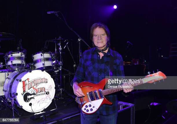 John Fogerty poses for a photo with his 1969 Rickenbacker 325 Sunburst guitar with the word 'ACME' written on it that he played while in Creedence...