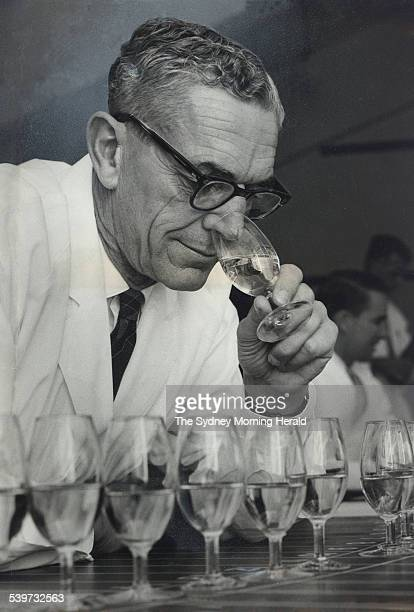 John Fornachon of South Australia director of the Australian Wine Research Institute Adelaide judges an entry in the wine section of the Sydney Royal...