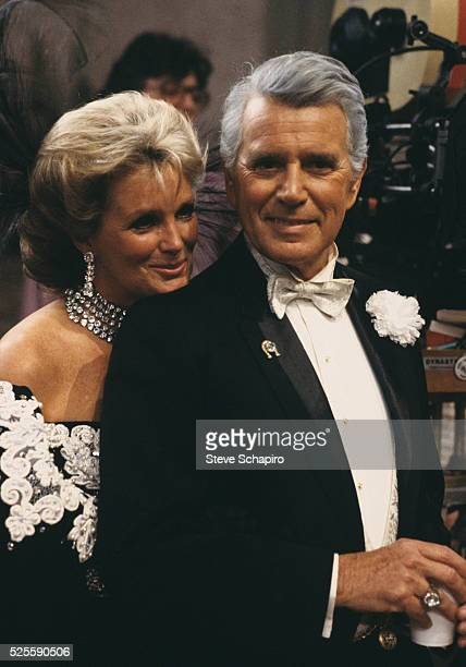 John Forsythe and Linda Evans on set of Dynasty