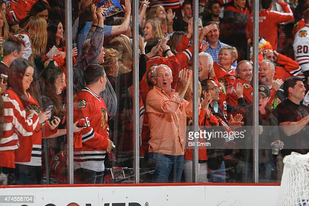 John Fox head coach of the Chicago Bears cheers after the Chicago Blackhawks scored against the Anaheim Ducks in the third period in Game Four of the...