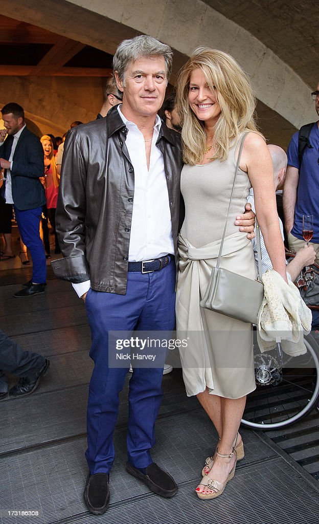 John Frieda and Avery Agnelli attend the private view of 'Miles Aldridge: I Only Want You To Love Me' at Embankment Gallery on July 9, 2013 in London, England.