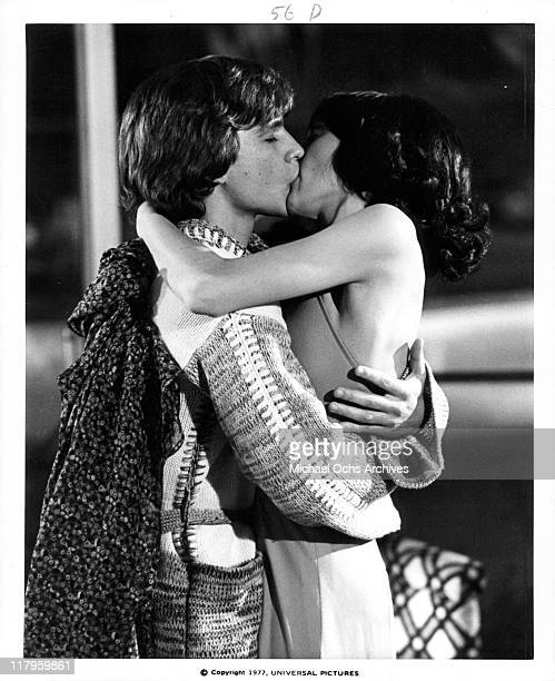 John Friedrich kissing Didi Conn in a scene from the film 'Almost Summer' 1978