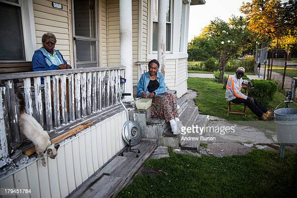 John Fullmore sits on his porch with his wife Magnolia Fullmore and their neighbor Pinkie Dawkin on September 3 2013 in Detroit Michigan Fullmore who...