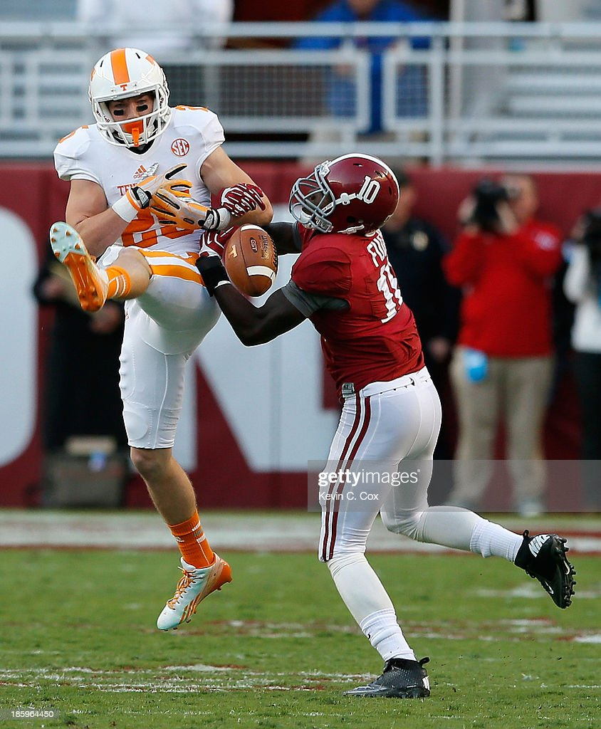 John Fulton #10 of the Alabama Crimson Tide breaks up a pass intended for Josh Smith #25 of the Tennessee Volunteers at Bryant-Denny Stadium on October 26, 2013 in Tuscaloosa, Alabama.