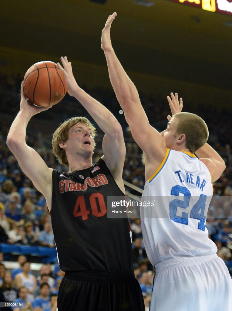 John Gage #40 of the Stanford Cardinal attempts a jumper over the hands of Travis Wear #24 of the UCLA Bruins at Pauley Pavilion on January 5, 2013 in Los Angeles, California.