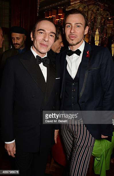 John Galliano and Alexis Roche attend a party in celebration of Edward Enninful in The Oscar Wilde Bar Hotel Cafe Royal on December 1 2014 in London...