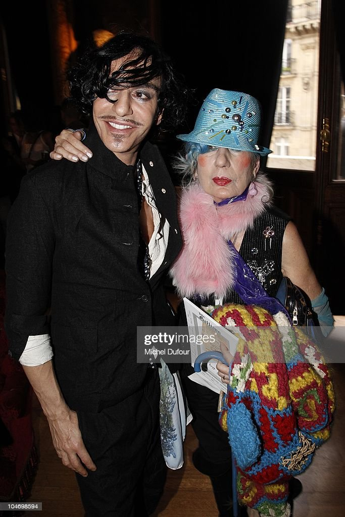 John Galliano and <a gi-track='captionPersonalityLinkClicked' href=/galleries/search?phrase=Anna+Piaggi&family=editorial&specificpeople=167086 ng-click='$event.stopPropagation()'>Anna Piaggi</a> attend the John Galliano Ready to Wear Spring/Summer 2011 show during Paris Fashion Week at Opera Comique on October 3, 2010 in Paris, France.
