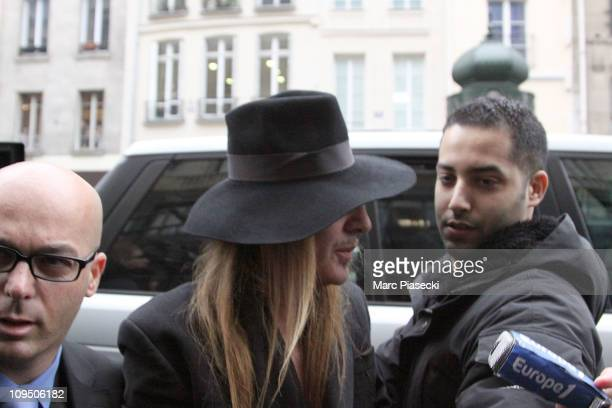 John Galliano and his lawyer Stephane Zerbib arrive at a police station on February 28 2011 in Paris France