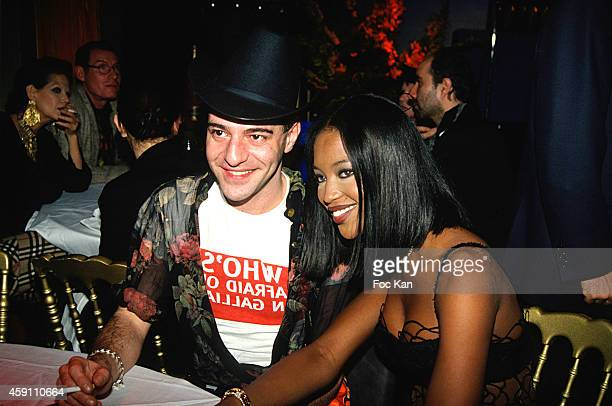 John Galliano and Naomi Campbell attend a Venus de La Mode Party at Les Bains Douches in the 1990s in Paris France