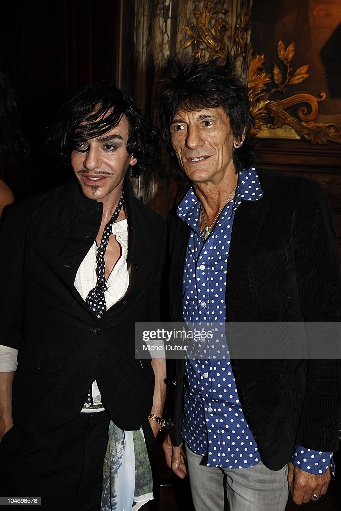 John Galliano and Ron Wood attend the John Galliano Ready to Wear Spring/Summer 2011 show during Paris Fashion Week at Opera Comique on October 3, 2010 in Paris, France.