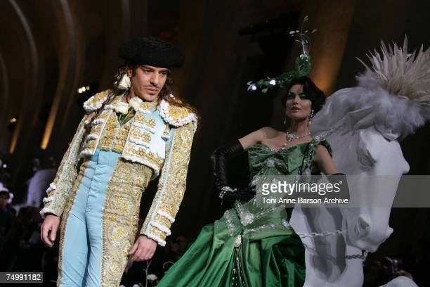John Galliano walks down the catwalk wearing Dior Haute Couture Fall/Winter 2008 on July 2 in Versailles France
