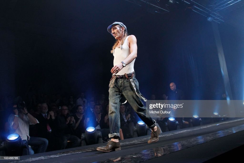 John Galliano walks the runway at the end of the John Galliano show as part of Paris Menswear Fashion Week Spring/Summer 2011 on June 25, 2010 in Paris, France.