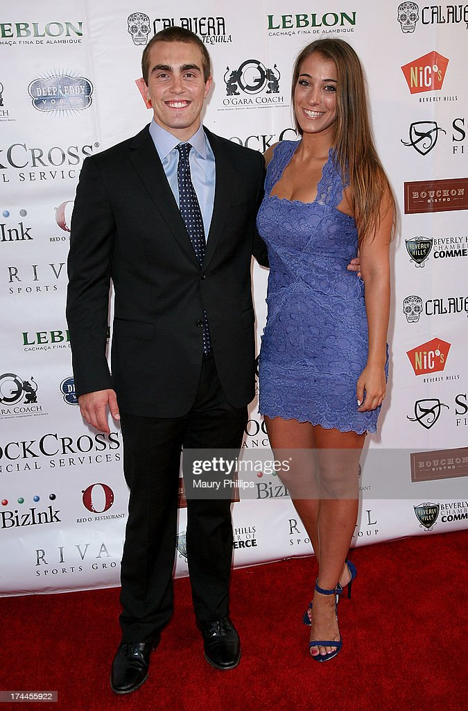 John Gebbia III and guest arrive at the 40th Anniversary StockCross Party on July 25, 2013 in Beverly Hills, California.