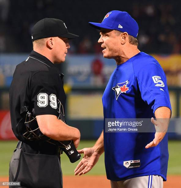John Gibbons manager of the Toronto Blue Jays exchanges words with home plate umpire Toby Basner after being ejected for arguing balls and strikes in...