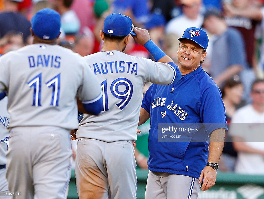 <a gi-track='captionPersonalityLinkClicked' href=/galleries/search?phrase=John+Gibbons&family=editorial&specificpeople=218120 ng-click='$event.stopPropagation()'>John Gibbons</a> #5 of the Toronto Blue Jays celebrates with Jose Bautista #19 and <a gi-track='captionPersonalityLinkClicked' href=/galleries/search?phrase=Rajai+Davis&family=editorial&specificpeople=810608 ng-click='$event.stopPropagation()'>Rajai Davis</a> #11 after defeating the Boston Red Sox at Fenway Park on June 29, 2013 in Boston, Massachusetts.