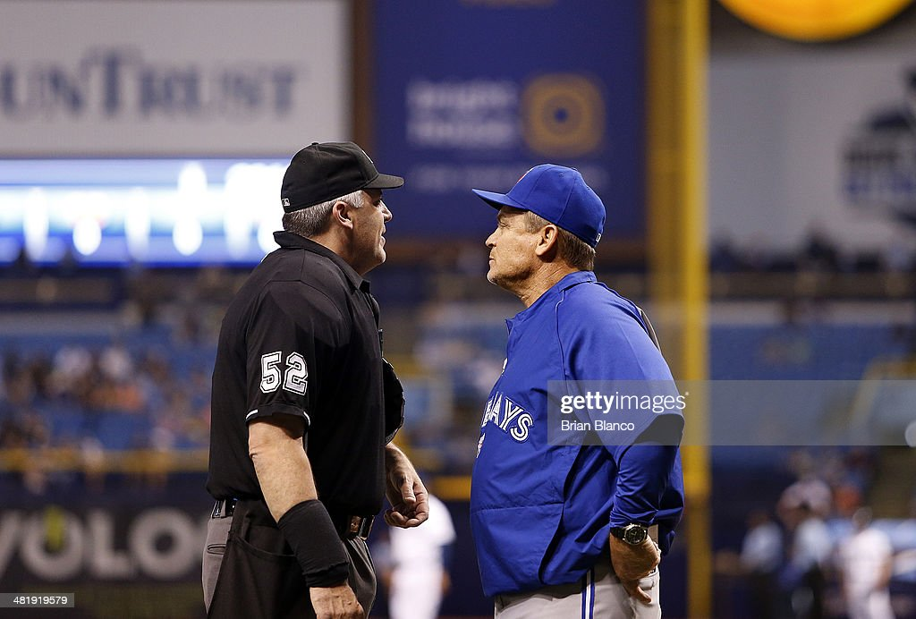 <a gi-track='captionPersonalityLinkClicked' href=/galleries/search?phrase=John+Gibbons&family=editorial&specificpeople=218120 ng-click='$event.stopPropagation()'>John Gibbons</a> #5 of the Toronto Blue Jays comes out to speak to umpire Bill Welke #52 before requesting an MLB replay to determine if a hit by Colby Rasmus of the Toronto Blue Jays was fair or foul during the seventh inning of a game against the Tampa Bay Rays on April 1, 2014 at Tropicana Field in St. Petersburg, Florida.